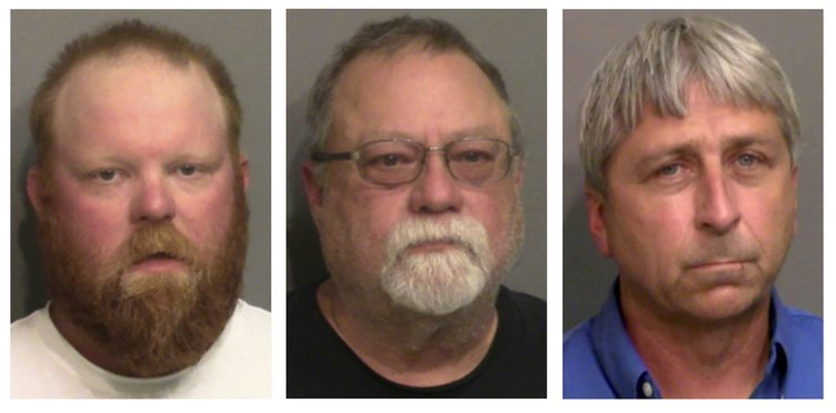"""This combination of booking photos provided by the Glynn County, Ga., Detention Center, shows, from left, Travis McMichael, his father, Gregory McMichael, and William """"Roddie"""" Bryan Jr. On Friday, Oct. 1, 2021, a Georgia judge has ruled that Ahmaud Arbery"""