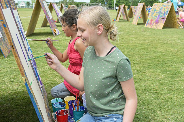During ArtsFest back in April, best friends Payton Adams, 9, front, and Kylie Worrell, 8, express their creativity with paint at  Mill Creek Regional Park. The Parks and Recreation Department will hold their fall ArtsFest event on Saturday at Mill Creek P