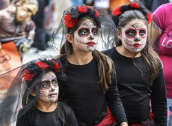 During the 2017 Scare on the Square event, Kimberly Radilla, left, and sisters Diana, center, and Jaqueline celebrated Halloween and Dia de los Muertos (Day of the Dead). The 2021 event is set for 9 a.m. to 1 p.m. on Saturday, Oct. 23  in downtown Statesb