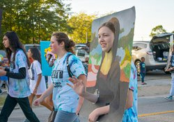 Dressed out as the Mona Lisa for the Statesboro High Arts Honors Society Living Museum, Hannah Weaver, 17, flashes a smile and a wave during the 2021 Kiwanis Ogeechee Fair Parade on Monday, Oct. 18.