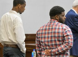 Defendants Thomas Isreal Cooper, left, and Brendyn Laroy Carter stand as the jury enters the courtroom on the first day of their trial on Monday, Oct. 18 for murder in the shooting death of Dexter Dunbar in Sept. 2019 .