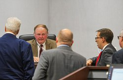 Judge John Turner, center, is shown at a sidebar with attorneys on Monday as the murder trial of Brendyn Laroy Carter and Thomas Isreal Cooper began in the shooting death of Dexter Dunbar in Sept. 2019. With only 11 jurors available Tuesday, Judge Turner