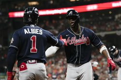 Atlanta Braves' Jorge Soler celebrates with Ozzie Albies after a home run during the first inning of Game 1 in baseball's World Series between the Houston Astros and the Atlanta Braves Tuesday, Oct. 26, 2021, in Houston.